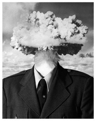 Underneath the words Mind. Blown is a picture of a man in a suit. The man's head is replaced by clouds of smoke representing an explosion.