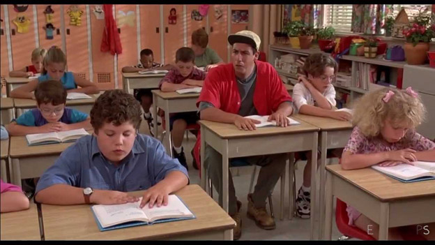 "An image from a move starring comic actor Adam Sandler. Adam Sandler is sitting at a desk in a classroom of young children all working on projects. The caption taken from the movie has Adam Sandler saying ""Today Junior""."
